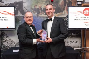 Car Dealer editor Colin Channon presents the award to Scott Staines